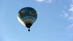 Big hot air balloon flying in the sky, blue balloon Stock Footage