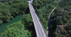 Aerial view of the bridge and the road  in the green valley of Tempe in Greece Stock Footage