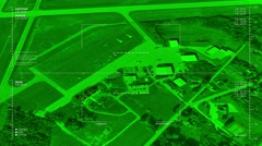 Night vision aerial  surveillance flyover of a small airport's terminal area Stock Footage