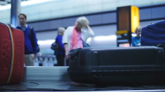 Out of focus airport passengers waiting for baggage 4K Stock Footage