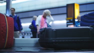 Stock Video Footage of Out of focus airport passengers waiting for baggage 4K