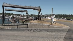 Pan R to L Ilwaco Boat Launch Ramp Stock Footage
