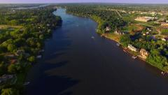 Beautiful Evening Aerial of the Fox River with Speed Boats Stock Footage