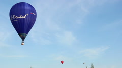 Blue hot air balloon flying in the sky Stock Footage