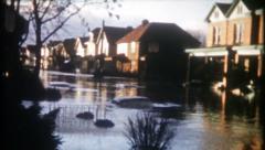 2346 - flooded streets in suburban neighborhood - vintage film home movie Stock Footage