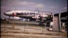 2345 - airport tarmac busy with traffic - circa 1950 - vintage film home movie Stock Footage