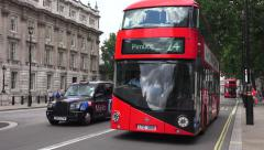 A New Routemaster bus (in 4K) on Whitehall, London, UK. - stock footage