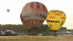 Hot air balloon leaves the ground and flies to the top, preparing to fly Stock Footage
