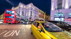 LONDON - JUNE 16, 2015: Traffic in Piccadilly Circus area. Piccadilly signs h - stock photo