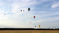Lots of colored balloons flying in the sky over the forest, fast shooting Stock Footage