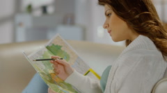 Young woman checking tour route on map, tourist planning trip Stock Footage
