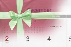 Tied bow and December calendar - stock photo