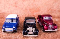 Vintage toy cars in an old background Kuvituskuvat