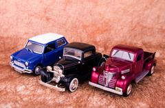Vintage toy cars in an old background Stock Photos