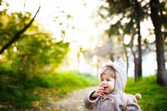 Funny Shy Little 2 year old Boy Giggling in the Park at the Sunset. Happy Chi Stock Photos