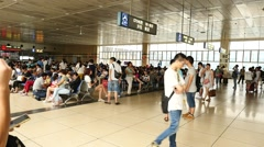 People hurrying in the China Shanghai railway station Stock Footage