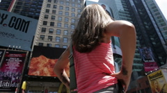 pretty woman pink tank top in middle Times Square camera circling panning NYC - stock footage