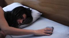 Phone call wake woman up Stock Footage