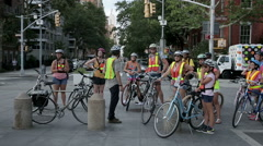 group of bicyclists in summer in Washington Square Park, Manhattan, NYC - stock footage