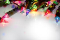 Closeup of Christmas lights glowing, copy space - stock photo