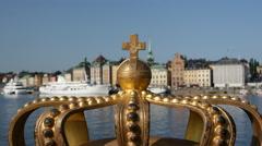 A golden Royal Crown on the Skeppsholmsbron bridge in Stockholm, Sweden. Stock Footage