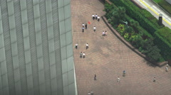 Aerial View Of Workers Walking In The Courtyard Of A Tokyo Skyscraper Stock Footage