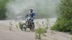 Dirtbike sand carve crash head first Stock Footage