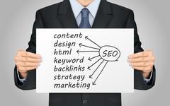 businessman holding SEO concept poster - stock illustration