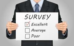 businessman holding quality survey poster - stock illustration