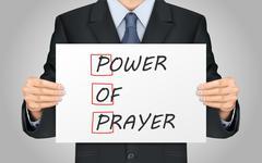 businessman holding Power Of Prayer poster - stock illustration