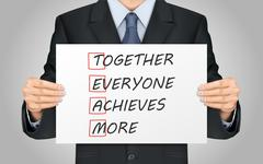 Businessman holding Together Everyone Achieves More poster Stock Illustration