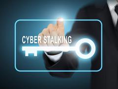 male hand pressing cyber stalking key button - stock illustration