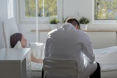 Sitting by patient - stock photo