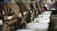 Chairs decorated for a wedding reception Stock Footage