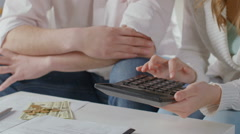 Wife and husband calculating family budget, low salary, no money Stock Footage