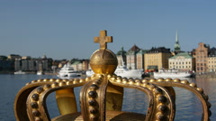 A golden Royal Crown on the Skeppsholmsbron bridge in Stockholm, Sweden Stock Footage