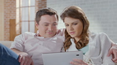 Couple viewing photos on tablet, choosing items in online shop Stock Footage