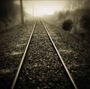 Railway tracks vanishing into the distance Stock Photos