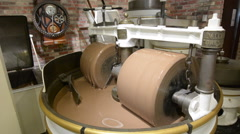 Chocolate manufacturing process in Ghirardelli Chocolate Company Shop Stock Footage