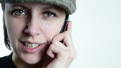 Flat cap, beautiful green eyed woman, she talk on phone, close up Stock Footage