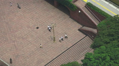 Aerial View Of Workers Walking On Stairs In The Courtyard Of A Tokyo Skyscrap Stock Footage
