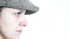 Flat cap, beautiful green eyed profile of woman, close up Stock Footage