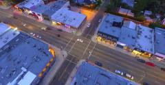 Aerial view intersection of Melrose Avenue and Curson Ave at dusk. Los Angeles. Stock Footage