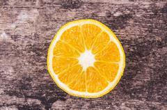 Orange slices on wood background Stock Photos