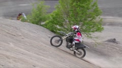 Dirtbike jumps hill slow motion Stock Footage