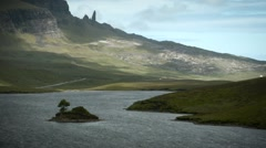 Loch Leathan overlooking The Old man of Storr - Isle of Skye, Scotland Stock Footage