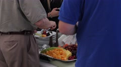 People getting food at a wedding reception Stock Footage