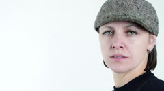 Flat cap, beautiful green eyed woman, smiling to camera, close up Stock Footage