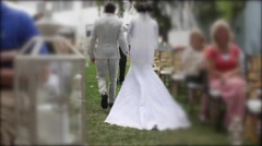 People walk down an aisle during a wedding ceremony Stock Footage