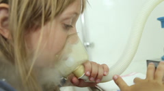 The girl is treated, making inhalation, uses the inhaler Stock Footage